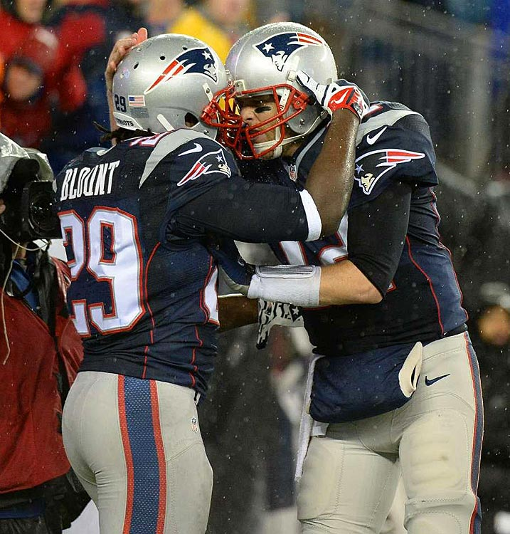 Brady and Blount celebrate after one of Blount's three first-half touchdowns.