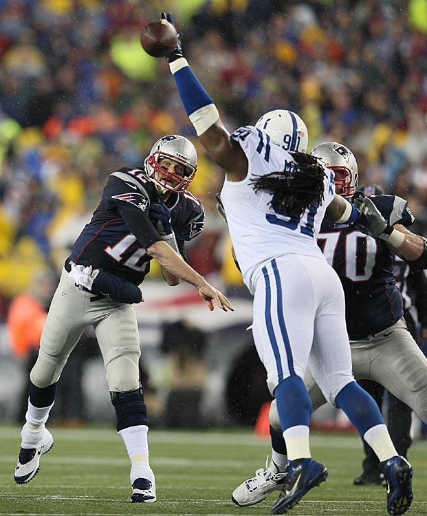 Ricardo Mathews appears to just barely miss deflecting this pass by Tom Brady, who completed 13 of 25 for 198 yards and no touchdowns.