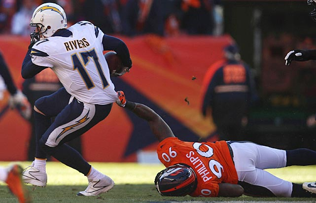 Philip Rivers attempts to break free from Shaun Phillips.