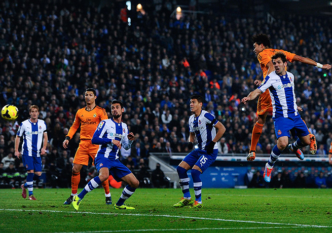 Pepe (top right, in orange) headed home the only goal in Real Madrid's victory over Espanyol.
