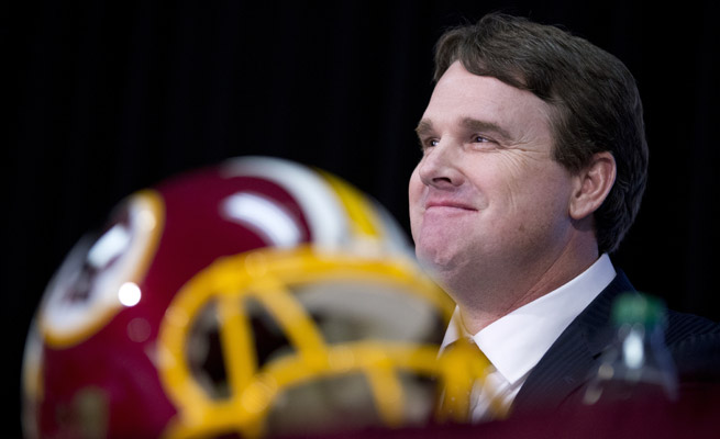 Jay Gruden's new gig as head coach of the Washington Redskins could be problematic for his brother, ESPN analyst Jon.