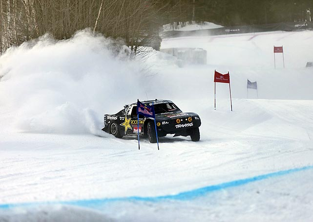 Off-road racer Rob Maccachren races his car through the snow during the Red Bull Frozen Rush in Newry, Maine.