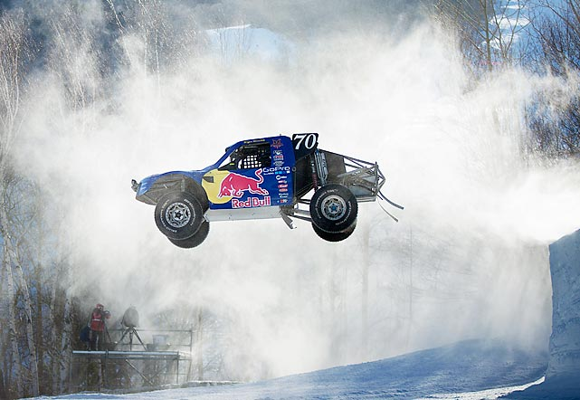 Bryce Menzies flies through the air in his car during the Red Bull Frozen Rush practice on Jan. 9. The competition featured off-road racing vehicles competing on snowy Maine terrain.