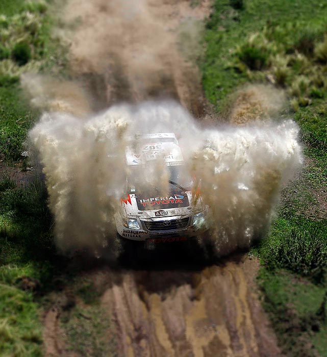 A vehicle races through rough terrain during the Dakar Rally, a two-week long trek through South American countryside. Three people have died during this year's rally, including one participant.