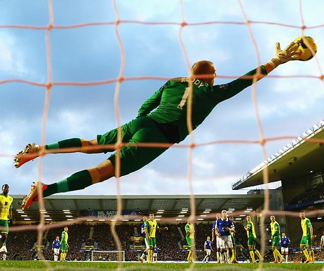 Norwich City goalkeeper John Ruddy attempts to stop a Kevin Mirallas free kick. The kick sailed into the back of the net from 20 yards, putting Mirallas and his Everton teammates up 2-0, which would ultimately be the final score.