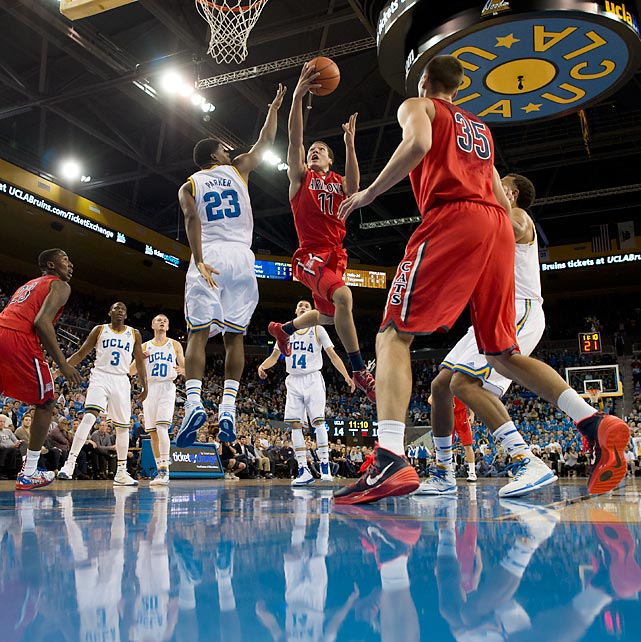 Freshman Arizona forward Aaron Gordon drives for a layup as UCLA's Tony Parker defends. Gordon's Wildcats remained undefeated in a 79-75 victory over the Bruins in the Jan. 9 contest.