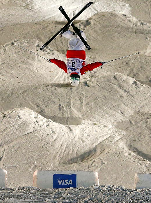 Freestyle skier Patrick Deneen of the U.S. jumps during the FIS Freestyle Ski World Cup Mogul Competition finals. Deneen finished in fourth.