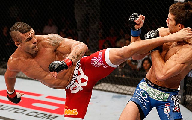 Luke Rockhold (right) got knocked out by this Vitor Belfort blow during their May bout in Brazil.