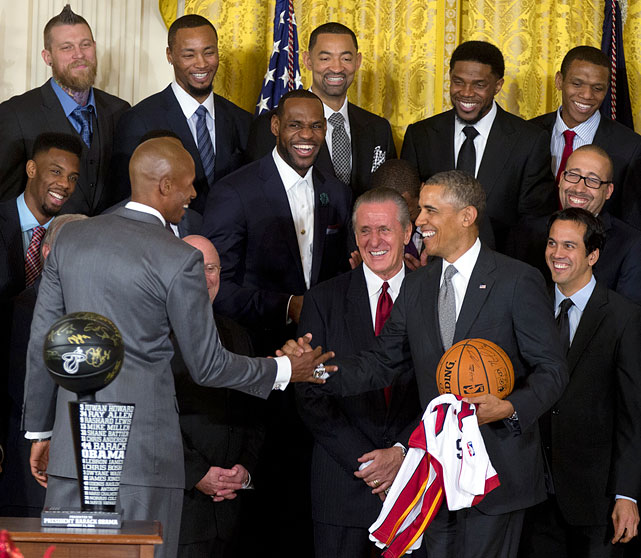 President Barack Obama welcomed the Miami Heat to the White House to honor their 2013 NBA championship on Tuesday Jan. 14, 2014. The presidential visit marked the second in a row for Miami, who met with Obama to celebrate their 2012 title last year. Obama delivered a speech that lasted for more than seven minutes and included a number of one-liners at the expense of various Heat players. As always, the former Illinois Senator got in a few lines about his beloved Bulls, too. The Heat also presented Obama with a trophy and a personalized jersey as part of the ceremony.