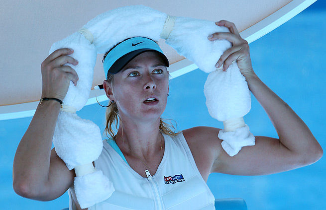 Maria Sharapova cools off with an ice towel and an ice vest during changeovers.