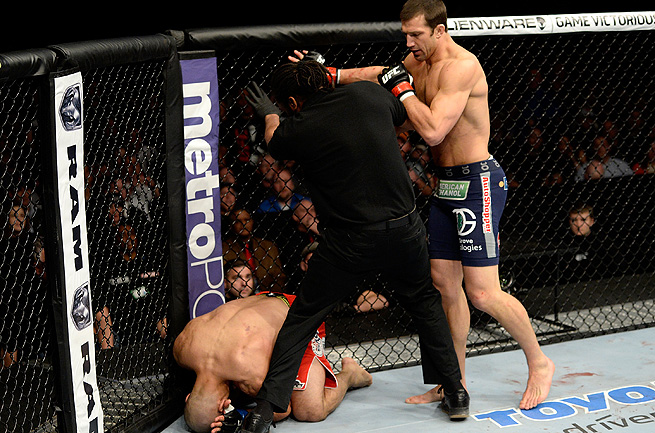 Luke Rockhold (right) dispatched Costa Philippou just 2:31 into Round 1 Wednesday night.