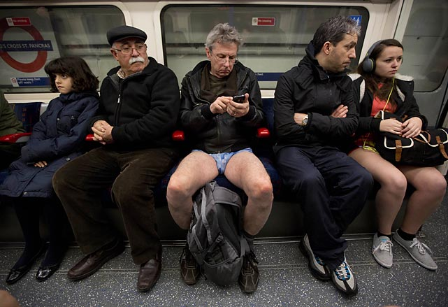 "This rather bawdy-sounding event is part of the ""Global No Pants Subway Ride"" where people board trains in the middle of winter without trousers and act as if nothing is amiss. This here charming scene was captured as an underground passed through King's Cross station in London on January 12."