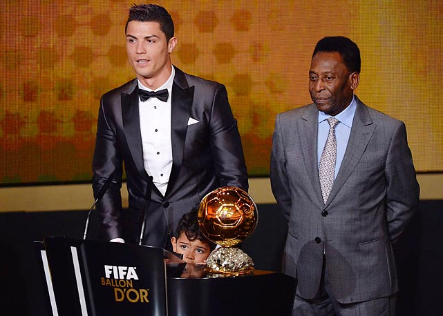 Kids these days ... The bestowal of the FIFA Balloon d'Or 2013 World Footballer of the Year award on Mr. Ronaldo was crashed by a wily street urchin (see if you can spot him) who reportedly made off with the soccer star's billfold and Pele's pocket watch during the gala evening in Zurich.