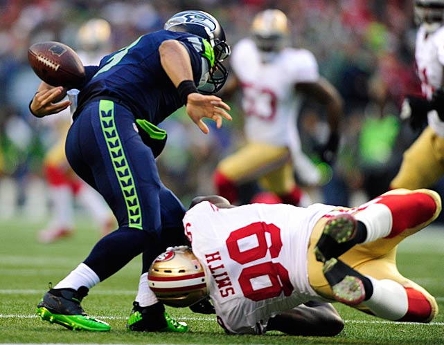 The Seattle quarterback tried to circle back to recover it, but Aldon Smith had other plans.