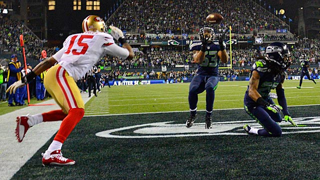 Malcolm Smith intercepts a ball deflected by Richard Sherman to preserve the Seahawks' six-point victory and send them to the Super Bowl..