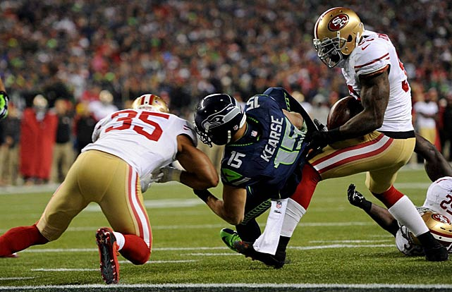 NaVorro Bowman strips the ball from Jermaine Kearse, only to have the refs rule Seattle possession. Making matters worse, Kearse fell on Bowman's leg, ending the defender's night with what was originally reported as a torn ACL.