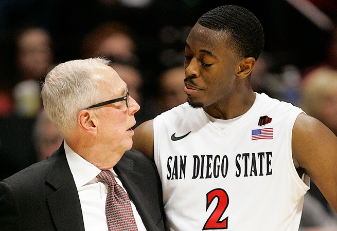 Steve Fisher speaks with leading scorer Xavier Thames, who has blossomed in his senior season.