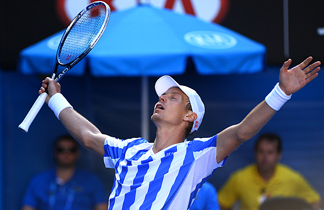 Tomas Berdych outlasted David Ferrer for his first victory ever on Rod Laver Arena.