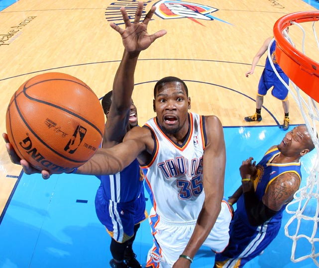 Kevin Durant of the Oklahoma City Thunder drives the lane during a Friday game between the Thunder and Warriors. Behind Durant's career-high 54 points, Oklahoma City topped Golden State 127-121.
