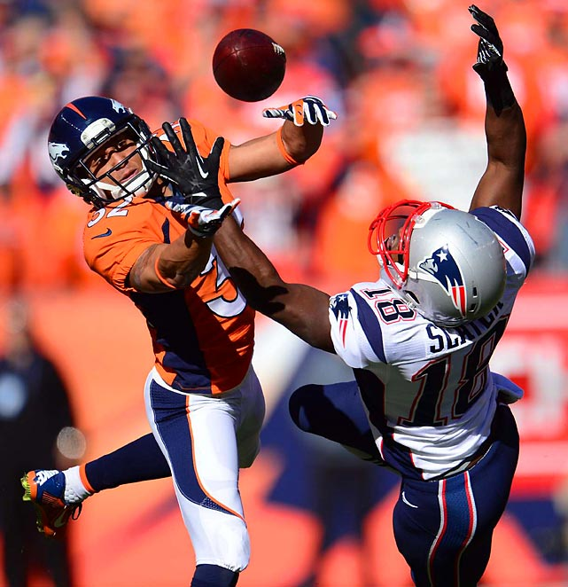 Denver defensive back Tony Carter and New England wide receiver Matthew Slater reach for the ball during the AFC Championship game in Denver. The Broncos won 26-16 and advance to the Super Bowl.