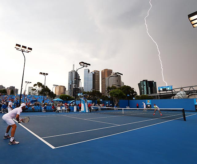 Lightning strikes near Melbourne Park during an Australian Open doubles match pitting Rameez Junaid and Adrian Mannarino against Rohan Bopanna and Aisam-Ul-Haq Qureshi. The match ended with a three-set victory for Bopanna and Qureshi.