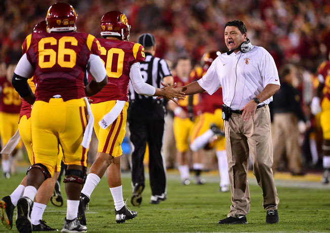 Despite sparking USC's midseason renaissance, Ed Orgeron (right) is currently a coach without a team.