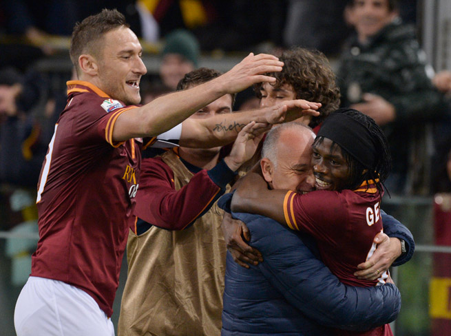 Gervinho, far right, celebrates with AS Roma after his goal that lifted the club past Juventus and into the semifinals of the Italian Cup.