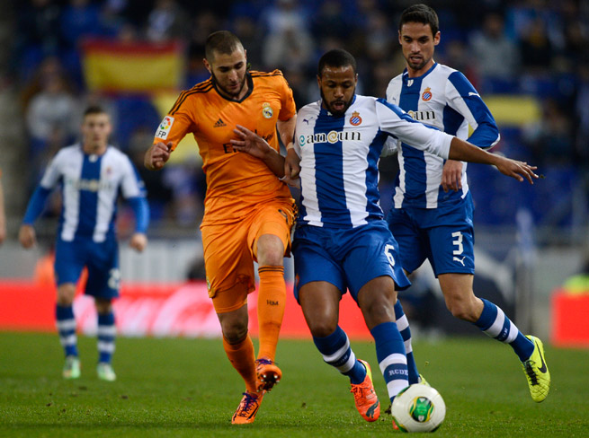 Real Madrid's goal-scoring hero Karim Benzema, third from right, battles with Espanyol's Sidnei Rechel during Madrid's 1-0 victory in the first leg of their Copa del Rey quarterfinal matchup.