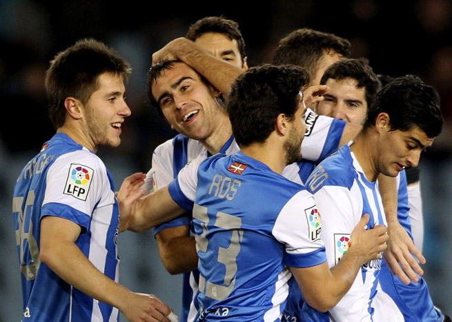 Real Sociedad celebrates a goal scored by Mikel Gonzalez, center, during a 3-1 win over Racing Santander in the first leg of their Copa del Rey quarterfinal Wednesday.