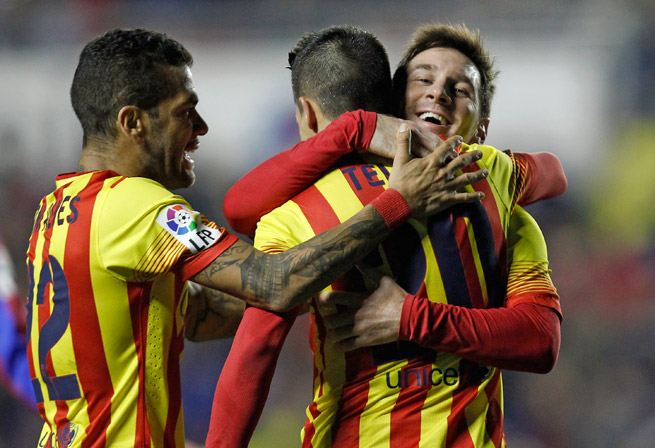 Lionel Messi, right, hugs Cristian Tello after setting up one of his three goals in Barcelona's 4-1 Copa del Rey victory over Levante on Wednesday.