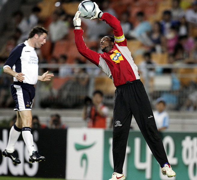 Mamelodi Sundowns goalkeeper Bafana Baloyi saves from Tottenham's Robbie Keane at the 2005 Peace Cup in Suwon, South Korea.
