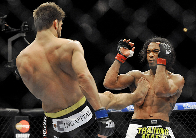 According to some onlookers, Benson Henderson (right) should have been saddled with a loss.