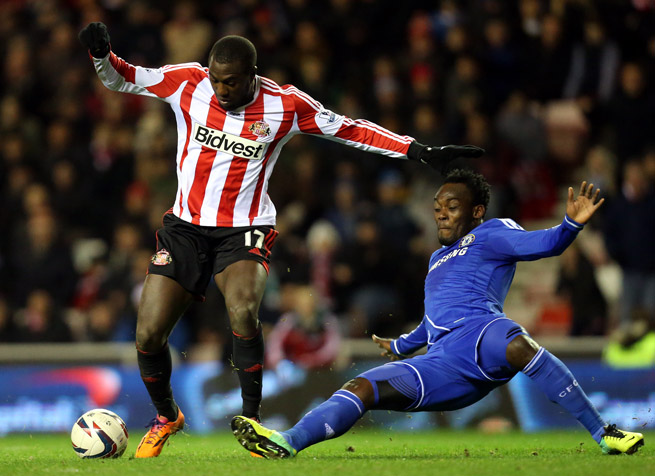 MIdfielder Michael Essien, right (tackling American Jozy Altidore), has left Chelsea for AC Milan after more than eight years with the London club.