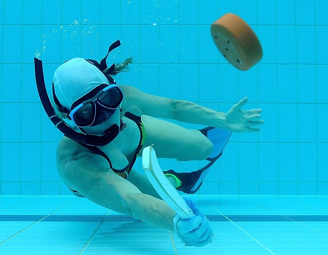 Clare Gleeson of Australia concentrates on the puck during the Australian Underwater Hockey Championships, which took place last weekend on Australia's Gold Coast.