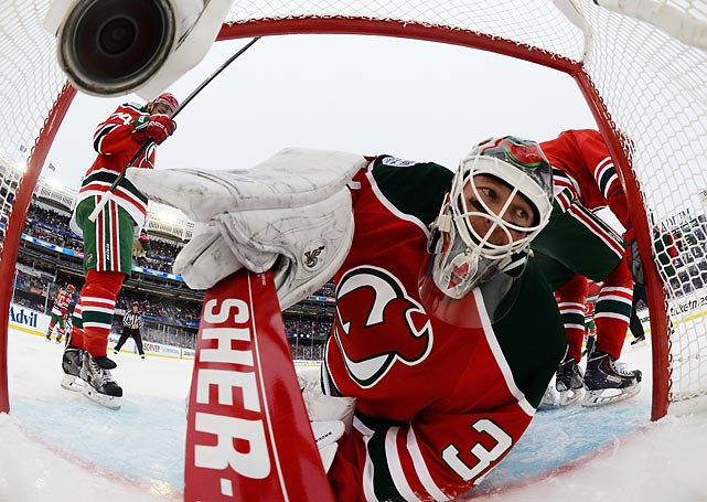 New Jersey Devils goaltender Martin Brodeur watches a puck fly past during the first period of an NHL Stadium Series game against the New York Rangers. Brodeur later criticized the conditions in which the game was played.