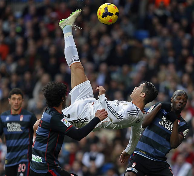 Real Madrid's Cristiano Ronaldo attempts to score on a bicycle kick during Saturday's La Liga match against Granada. Ronaldo scored one of Real Madrid's goals in a 2-0 victory.