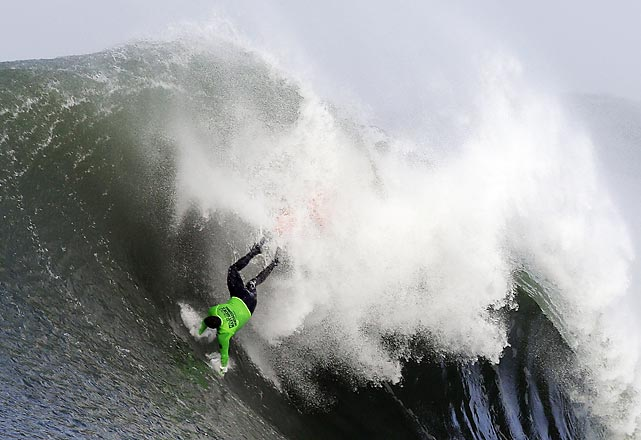 Surfer Ben Wilkinson falls during the third heat in Friday's Mavericks Invitational big wave surf contest.