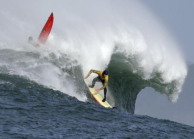 Ryan Seelbach rides a wave during the first round in Friday's Mavericks Invitational.