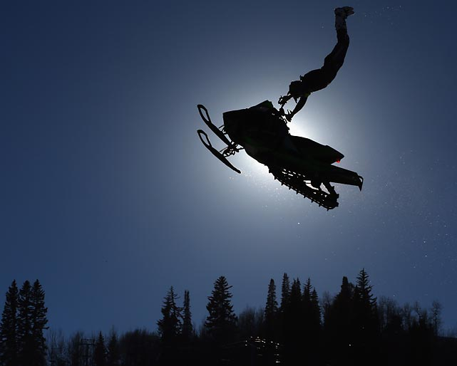 An competitor takes a practice run before the snowmobile freestyle finals at Winter X-Games 2014. Colten Moore earned the gold medal in Thursday's event, which took place in Aspen.