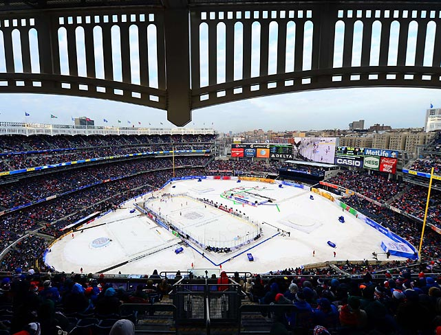 Fans take in a hockey game between the New Jersey Devils and New York Rangers played outdoors at Yankee Stadium. The Rangers claimed a 7-3 victory.