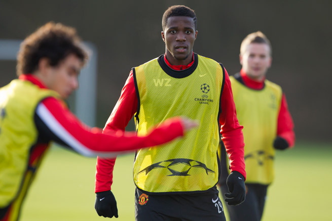 Manchester United's Wilfried Zaha, center, will spend the rest of the season on loan at Cardiff City.
