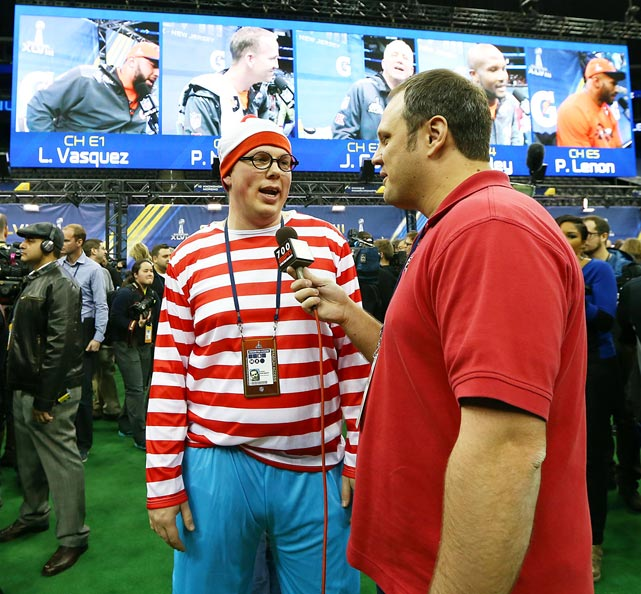 A member of the media dressed as Waldo attends Media Day for Super Bowl XLVIII at the Prudential Center in Newark, NJ.