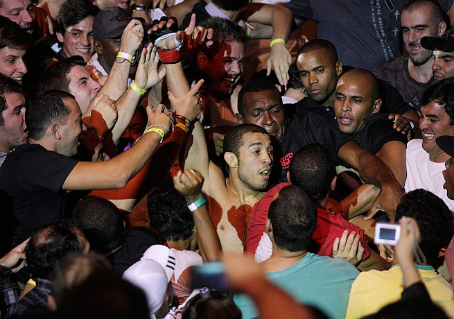 José Aldo was engulfed by the crowd in Rio de Janeiro after he defeated Chad Mendes in 2012.