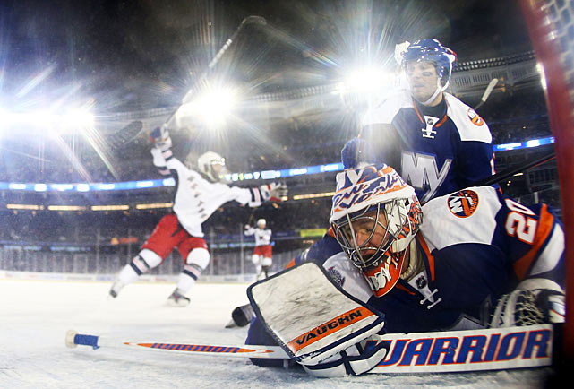 Both teams' offenses were cold as the puck danced unpredictably across hard ice pockmarked with holes and cracks, but the Rangers managed to score twice and that was enough to edge their rivals, 2-1.