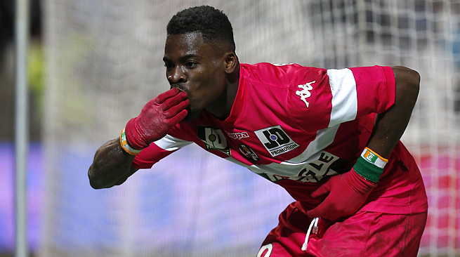 Toulouse's Aurier celebrates after his goal against Olympique Marseille. The game finished tied 2-2.