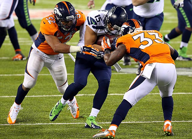 Jermaine Kearse escapes the grasp of Wesley Woodyard and Duke Ihenacho to score a touchdown. He made four receptions for 64 yards.
