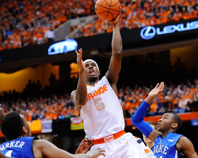 Syracuse forward C.J. Fair shoots during a Saturday game between the Orange and Duke. Fair finished with 28 points in a 91-89 overtime victory over the Blue Devlis.