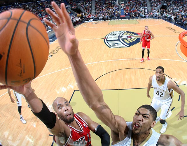 Taj Gibson of the Chicago Bulls attempts to lay the ball in as Anthony Davis of the New Orleans Pelicans defends. The Pelicans won 88-79, thanks in part to 24 points from Davis.