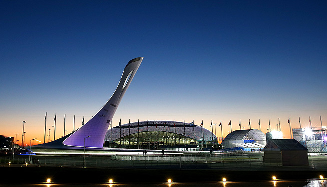 The Olympic Cauldron and the Bolshoy Ice Dome sit waiting for competition to start Thursday.