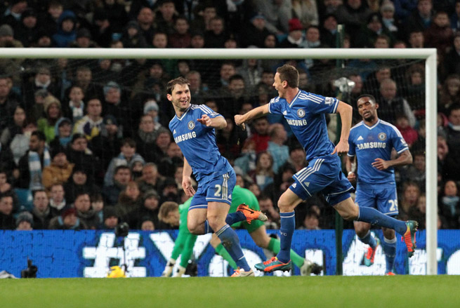 Branislav Ivanovic, left, celebrates his goal that gave Chelsea a 1-0 win at Manchester United on Monday.